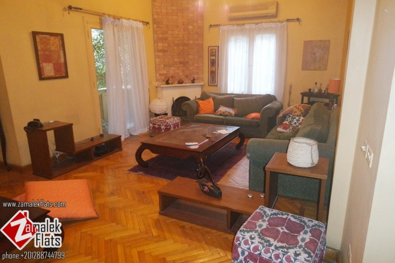 High Ceiling + south Zamalek + Well Decorated + Open Kitchen